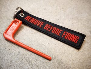 "Hobo Apparel ""REMOVE BEFORE FIRING"" Chamber Flag - Black/Red"
